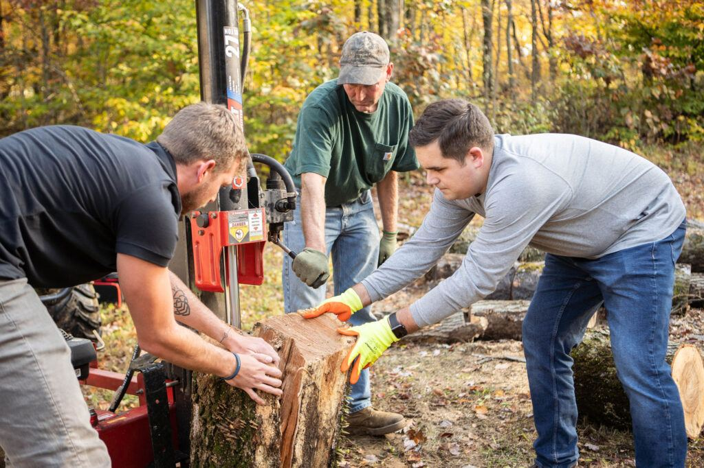 AOS group cutting a tree